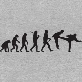 camiseta gris Chuck Norris pies Evolución en la boca